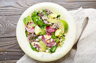 Top view at mediterranean roasted beet salad with avocado walnut