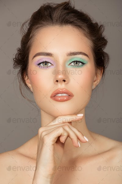 Fashion Portrait Of Young Woman. Colorful Eye Shadows.