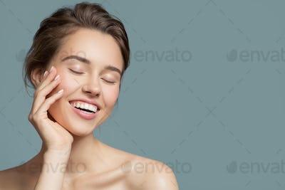 Portrait Of Smiling Beautiful Woman. Perfect Skin.