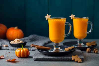 Pumpkin Latte, Smoothie with Spices. Grey Background. Copy Space.