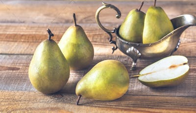 Pears on the wooden background