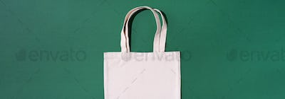 Canvas tote bag canvas and linen fabric bags with drawstring on green background with copy space
