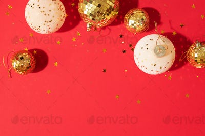 Christmas composition. Flat lay, top view. Disco ball bauble, star sparkles. Minimal New year party