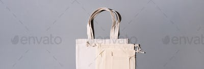 Canvas tote bag canvas and linen fabric bags with drawstring on grey background with copy space. Top