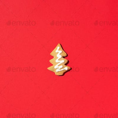 Homemade christmas cookies on red background. Gingerbread fir-tree. Top view. Christmas and New year