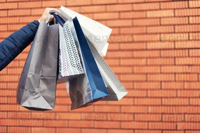 Man with bunch of shopping bags. Copy space. Sale, discount, black friday concept. Shopping mall and