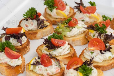 Closeup of delicious canape served on white plate