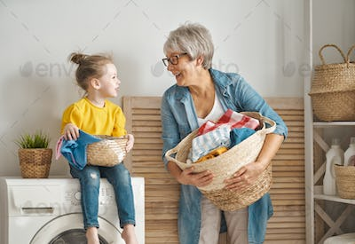 grandma and child are doing laundry