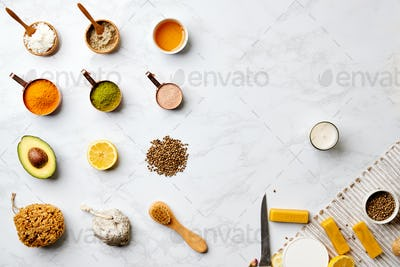 Overhead View Of Natural Beauty And Health Products In Measuring Cups On Marble Background