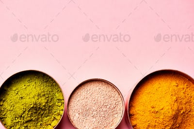 Overhead View Of Natural Beauty And Health Products In Measuring Cups On Pink Background