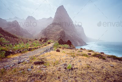 Panoramic view of stony hiking path to Ponta do Sol over amazing arid Aranhas valley with huge