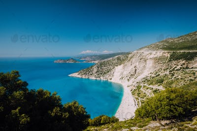 Beautiful view of Myrtos beach in high tourist summer season. Myrtos is one of the famous beaches in