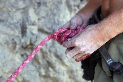 Climber's hands close-up. Mountain climbing elements