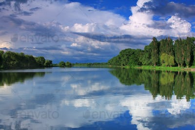 Reflection of the cloudy sky in the lake