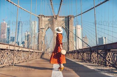Young tourist on the Brooklyn Bridge