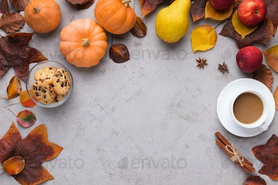 Rich and bright autumn harvest with coffee cup on gray