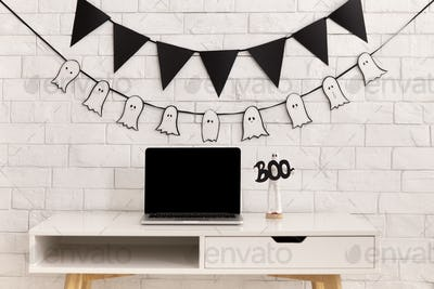 Halloween decorations in modern office with laptop