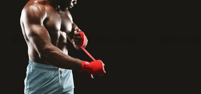 Cropped image of boxer getting ready for fight