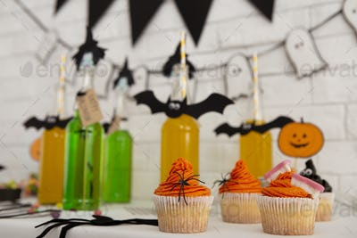 Close up of Halloween drinks and food for sweet party in office