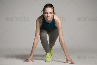 Young Active Sprinter Woman Prepare For Start