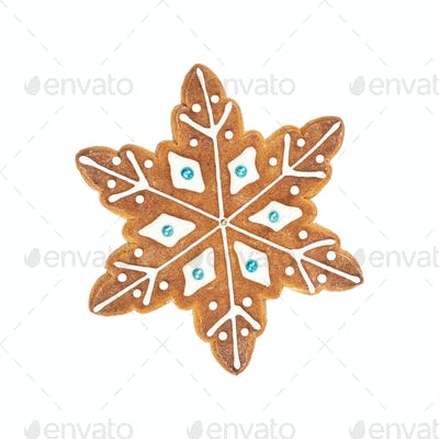 Traditional Christmas gingerbread in the shape of snowflake isolated on white