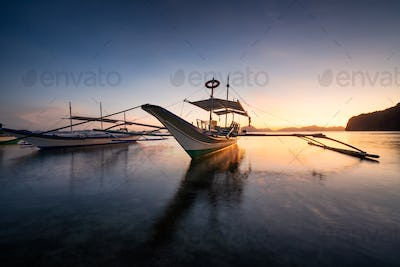 Tropical harbor bay in evening. Golden hour in lagoon in Philippines, Palawan, El Nido. Sunset on