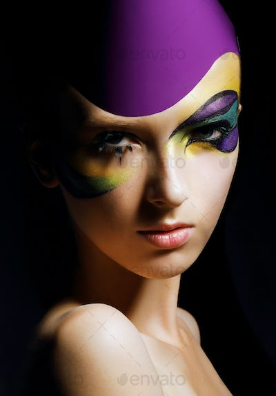 Young woman with fancy colorful makeup