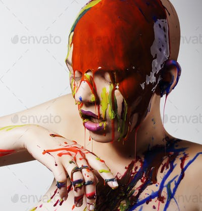 Woman with multicolored paint on head and body