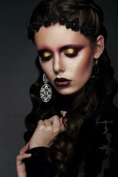 Fashionable woman with creative art eye makeup