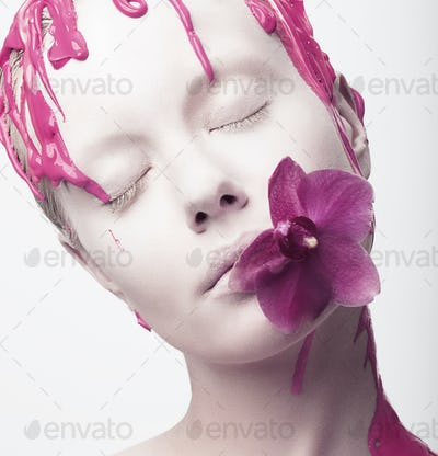 Painted Woman's Face with Pink Flower in her Mouth