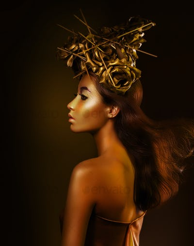 Fantasy. Enigmatic woman covered in gold color