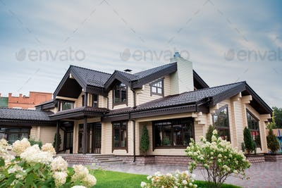 View of luxurious modern house with decorative elements around windows