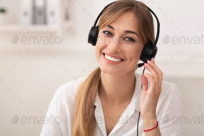 Smiling Woman In Headset Working In Call Center Office