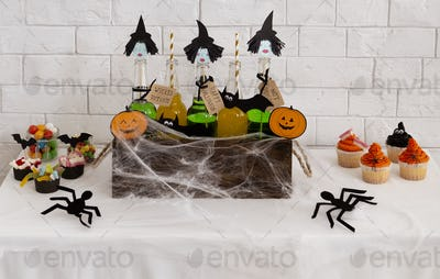 Halloween spiders wrapping up in a web three witches drinks