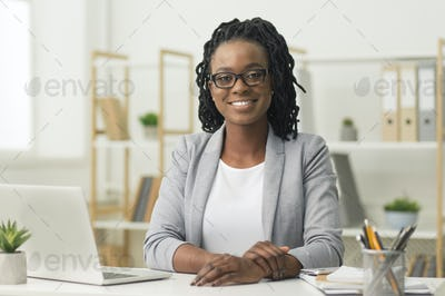 Afro Business Lady Smiling At Camera Sitting At Workplace