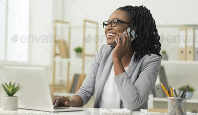 Happy Office Girl Talking On Phone Using Laptop Indoor