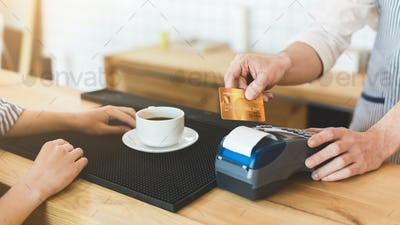 Credit card payment in cafe for morning coffee