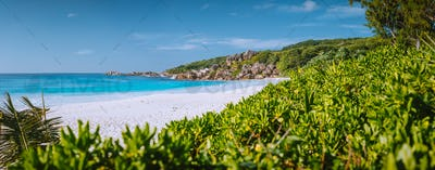 Most beautiful beach Grand Anse on La Digue Island, Seychelles with granite rock formations, white
