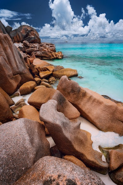 Grande anse located on La Digue island, Seychelles. Sandy beach with orange granite boulders and
