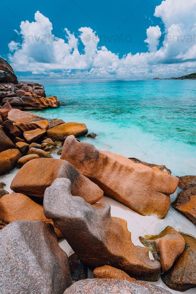 Beautifully shaped granite boulders in evening light at Grand Anse beach, La Digue island