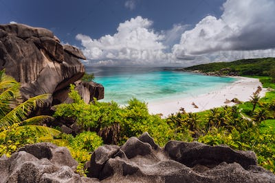 Grand Anse beach with Rainy clouds. La Digue island, Seychelles