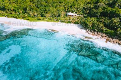 Aerial photo of bizarre paradise tropical beach Anse Bazarca at Mahe island, Seychelles. White sand