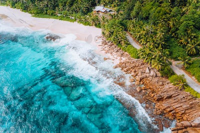 Aerial view of tropical dreamy beach Anse Bazarca, Mahe island, Seychelles. White powdery sand