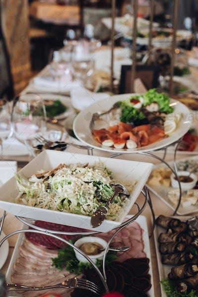 Fully-served banquet table at wedding. Wedding festive banquet