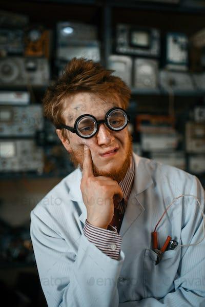 Portrait of strange male scientist in glasses