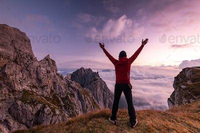 Happy Active Man at High Mountains Peak at Sunrise