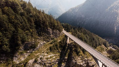 Bridge in Mountains Over Valley, Mangart, Slovenia. Aerial View