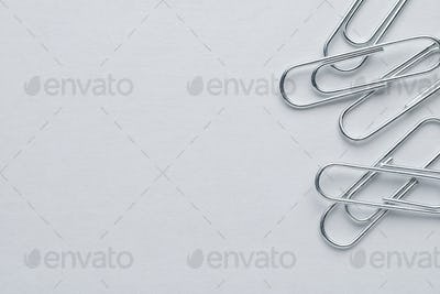 Metal paper clips on white background with copy space