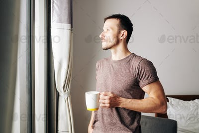 Young man enjoying new morning