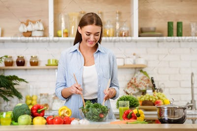 Healthy Eating. Woman Mixing Fresh Salad In Kitchen